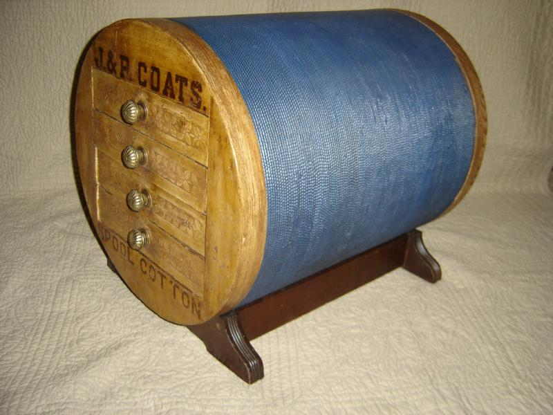 Iron Horse Antiques, J & P Coats spool cabinet, shaped like giant spool.